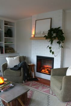 Fireplace Reveal- Our Electric Brick Fireplace Our Painted White Brick Electric Fireplace Brick Fireplace Mantles, Brick Fireplace Makeover, Small Fireplace, Home Fireplace, Fireplace Remodel, Living Room With Fireplace, Fireplace Surrounds, Fireplace Design, Living Room Decor