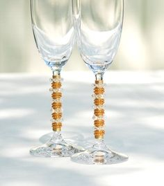 Quality crystal glass champagne flute that is beaded in a mix of SWAROVSKI Austrian CRYSTALS, FRESH WATER PEARLS and Czech glass beads.