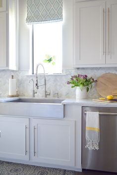 design decision gone wrong / white carrara marble herringbone backsplash / white kitchen /