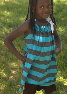 Turn a large adult t-shirt into a little girl's sundress @Ashlie Alexander. How cute is this little girl in the dress! It would be cute on Livi too!