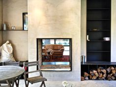 Outdoor fireplace looking in, glass-backed steel and stucco