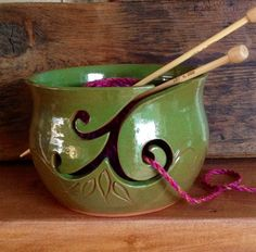 Yarn Bowl - Hand thrown green yarn bowl with simple scroll yarn feed. Made in white earthenware clay.  This simple yet attractive bowl is designed to keep your