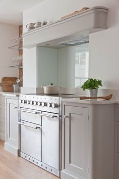 Mercury range cookers in a pale grey and white kitchen in a London Townhouse basement room. Edmondson Interiors. www.edmondsoninteriors.co.uk.