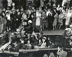Newly-discovered stark black and white photograph of John F. Kennedy in his infamous Dallas motorcade, seated next to his wife Jackie and surrounded by thrilled onlookers.  via http://www.dailydot.com/news/new-kennedy-photo-facebook-share/