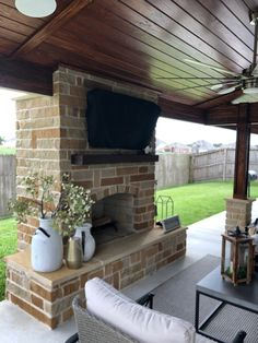 Beautiful stained 1x6 tongue and grove pine ceiling.  Stone outdoor fireplace with tv mounted above.   www.backyard-retreat.com