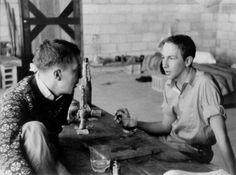 Robert Rauschenberg in conversation with Jasper Johns, 1954. Photo by Rachel Rosenthal