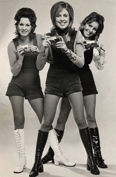1971: Women hold Kodak cameras at the Ideal Home Exhibition.