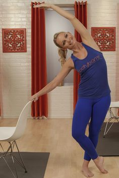 Tone your trouble zones to look good from all angles with this at-home barre workout with trainer Tracey Mallett — all you need is a chair!
