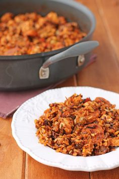 This Chicken and Chorizo Salsa Skillet is an easy one-pot meal that your family will love! Perfect for a weeknight dinner and just 343 calories or 8 Weight Watchers points per serving. www.emilybites.com