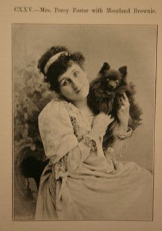 Mrs. Percy Foster, with her Moorland Brownie, Pomeranian.