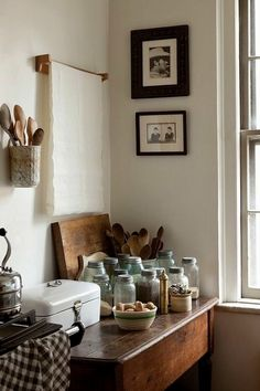 Hanging pot on wall for cooking utensils, table, wood, white walls, kitchen, idea.