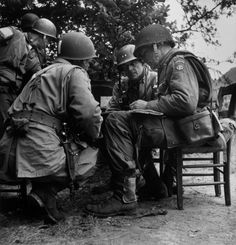 Saint-Sauveur-Le-Vicomte, Manche. June 16, 1944. General Matthew B. Ridgeway, commander of the US 82nd Airborne Division, meeting with his officers//Robert Capa