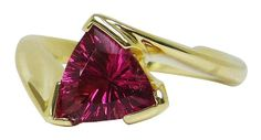 Ring by Tom Dailing featuring a trilliant-cut pink tourmaline in 18K gold.