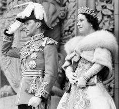 Press photograph of King George VI saluting his guard of honour, and Queen Elizabeth as they were about to leave the Dominion Parliament, in Ottawa, where he gave the Royal assent to a number of bills.
