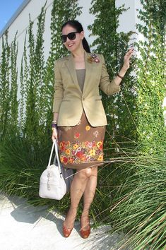 Ralph Lauren Silk-Linen Blazer & Sunglasses; Neiman Marcus Cashmere Top; Silk Club Collection Wrap Skirt; Leather Cole-Haan Bag & Woven Leather Shoes; Monet & Vintage Brooches; Omega Watch.  Khaki with yellows, purples & reds becomes a lively and elegant combination.  http://www.akeytothearmoire.com/post/26138374717/garden-trellis