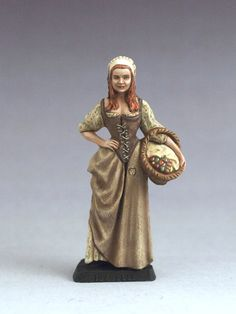 Isabelle, the Innkeeper's Daughter. I don't know anything about this mini other than she's a nice little 54mm plastic model.