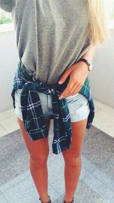 Gray tee, denim shorts and a plaid button-up tied around the waist.