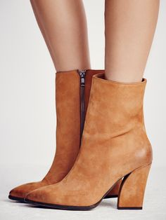 Mystic Charms Heeled Boot | Featuring a pointed toe and a custom designed modern shaped heel, this mid-rise boot is the perfect outfit completer. In a luxe leather with an inside side zip for an easy on-off and a padded footbed for a comfortable fit.