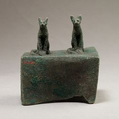 Two cats surmounting a box for an animal mummy Period: Late Period–Ptolemaic Period Date: 664–30 B.C. Geography: From Egypt Medium: Copper alloy
