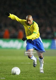Roberto Carlos of Brazil runs with the ball during the International Friendly match between Republic of Ireland and Brazil held on February 18, 2004 at Lansdowne Road, in Dublin, Ireland. The match ended in a 0-0 draw.