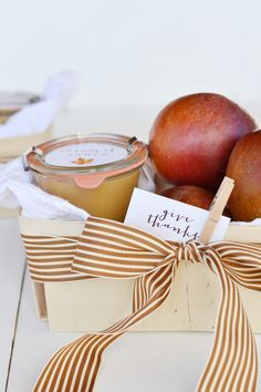 Okay, so you made the world's easiest caramel sauce... Now what? Here's  what I say: give it away! Your friends will love it, your friends' kids  will love it even more. It will become a fall favorite (so be prepared to  make it every year).  I have a ton of extra gift baskets left over from our wedding, so I wanted  to make something fun to give away to friends this thanksgiving (last year  I made cranberry sauce). Plus, I needed to get rid of the extra apples I  seem to always be…