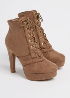 Make an impression in these stylish booties. Made with faux suede, they feature scalloped edging for a flirty look.
