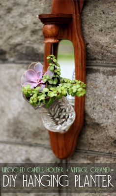 Tutorial for a DIY hanging planter made out of an old candle holder and a creamer!  Well there is a great idea.   I see these holders at garage sales all the time.......oh my spray paint!