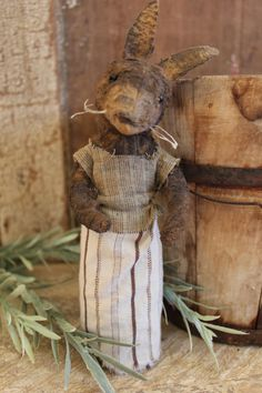 How sweet ! A wee little rabbit that would tuck in your pocket ! Made by me. Painted and distressed wearing simple country clothing. Not freestanding, fun to tuck anywhere !  9'' high ♥ SOLD   1 of  3