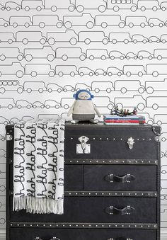 How cute is this wallpaper?! LOVE this modern look for an accent wall. #BoyNursery #CarouselDesigns