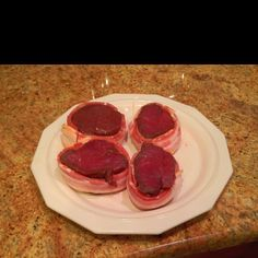 Venison steaks wrapped in bacon.