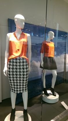 Orange pairs perfectly with black and hounds-tooth. Orange cable-knit 3/4 sleeve sweater or sleeveless blouse from @hm.