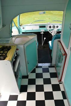 Interior part 2 the a Tiffany blue redone hippie van. Kitchenette/driver's seat.