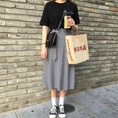 T-shirt, midi skirt, and sneakers