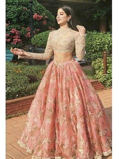Get yourself dressed up with the latest lehenga designs online. Explore the collection that HappyShappy have. Select your favourite from the wide range of lehenga designs Indian Gowns Dresses, Indian Fashion Dresses, Dress Indian Style, Prom Dresses With Sleeves, Indian Designer Outfits, Pakistani Dresses, Dress Fashion, Designer Dresses, Groom Fashion