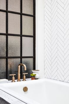herringbone-inspired bathtub tiling