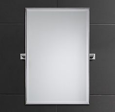 Photo On RH us Modern Traditional Pivot Mirror With its squared edges and bull nose finials