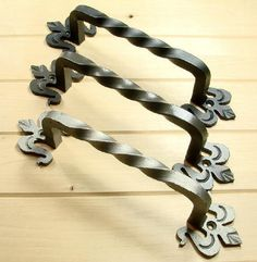 Fleur de Lis Twisted Iron Door Pull Made of forged iron with fancy impression details Measures d