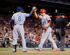 The American League's Lorenzo Cain (left) of the Royals and Mike Trout of the Los Angeles Angels congratulated each other after a two-run fifth inning Tuesday night at Great American Ball Park in Cincinnati.