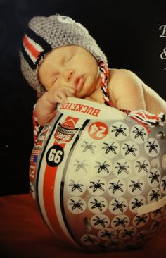 Adorable first photo idea :-)  OHIO STATE Helmet Hat Scarlet and Grey by HotOffTheHookCrochet, $35.00. Someone posted this on interest and I happen to stumble upon it... It's Emme in Tyler's helmet!! Haha! :) Let's Keep #Emme trending!