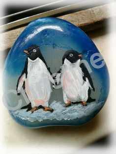 penguins painted on stone