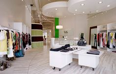 LOVE the rolling tables  Mititique Boutique: Fashion Boutique Interior With Modern Style