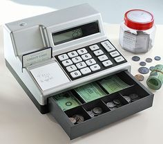 "Cash Register & Play Money. Features On/Off Button, SolarPowered Calculator and a Real Beeping Sound (Battery Included) Keypad is designed for small hands. Cash and Coins are slightly larger than real money  making them easy to handle while helping kids practice counting & coin recognition. 11.5"" wide x 10"" deep x 6.5"" high ' Price: $19. Phone: 1.800.993.4923 ' 7 days a week. 5:am – 9:pm (PST)"