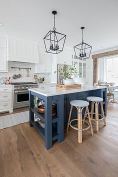 This Blue Note by Benjamin Moore painted island gives a pop of color to this lake house kitchen. Blue Kitchen Island, Kitchen Island Storage, Kitchen Island Decor, White Kitchen Cabinets, Kitchen Redo, Kitchen Layout, Home Decor Kitchen, New Kitchen, Home Kitchens