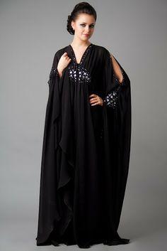 A beautiful abaya with diamonds around the waist and wrists.