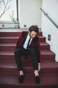 Modern and edgy groom style with a burgundy velvet jacket and black velvet loafers | Image by a sea of love