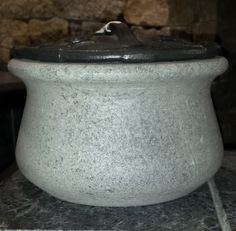 """Beautiful design and function come together with Hearthstone's Soapstone Steamer. Made from high quality Soapstone this steamer will humidify the air during the winter months of wood stove use. The Blue/Black enamel finish on the cast iron lid will help prevent rusting. 4.5"""" tall X 7.5"""" diameter 2 Qt. capacity 10 lb. wt. Available at Higgins Energy Alternatives in Barre, MA"""