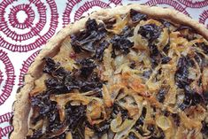 Onion Tart with Greens and Cashew Cream. Uses a chickpea flour tart crust that sounds very intriguing.