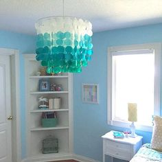 mermaid bedroom Our Ombre Capiz chandelier is on point in this bedroom from
