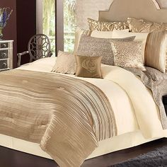 daisy fuentes Gold Dust Bedding Coordinates- Kind of intense, but some of those pillows are cute!