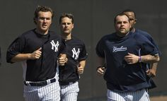 New York Yankees' Phil Hughes (L-R), Matt Daley and Joba Chamberlain run poles during a workout at the team's spring training complex in Tampa, Florida, February Joba Chamberlain, Yankees Spring Training, New York Yankees, Bomber Jacket, Tampa Florida, Baseball, Running, Workout, February